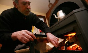maintaining the fire in a wood burning stove